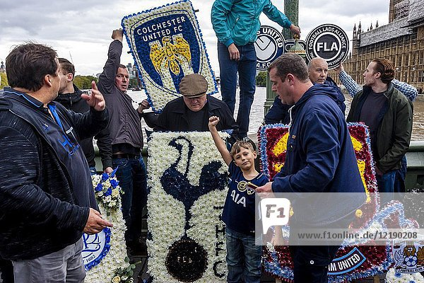 Football fans from across the Uk place floral tributes on Westminster Bridge to remember victims of the recent terror attack  Football Lads Alliance march against extremism  London  UK.