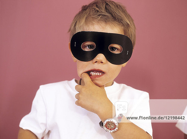Portrait of little boy wearing black eye mask