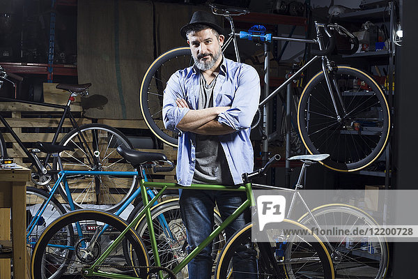 Portrait of confident man in bicycle workshop