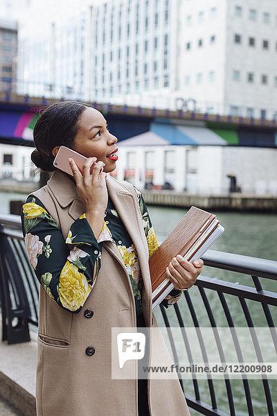 UK  London  fashionable businesswoman on the phone
