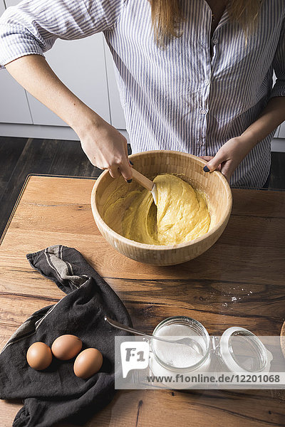 Woman stirring dough