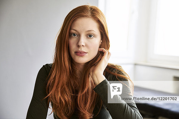 Portrait of serious redheaded woman