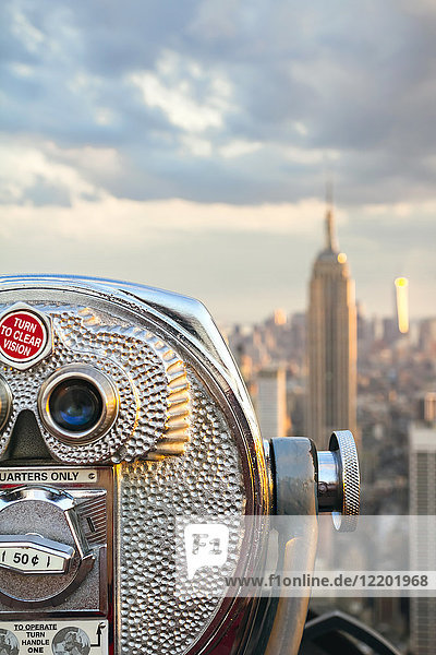 USA  New York  Manhattan  Close up of telescope  Empire State Building in background