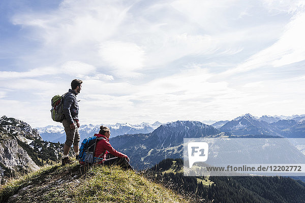Austria  Tyrol  young couple in mountainscape looking at view