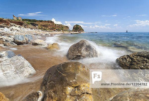 Waves crashing on rocks  Cala Seregola  Capo Pero  Elba Island  Livorno Province  Tuscany  Italy  Europe
