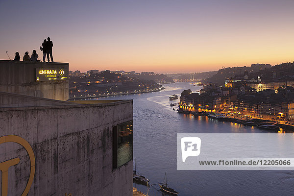 View from Vila Nova de Gaia View over Douro River at sunset to Ribeira District  UNESCO World Heritage Site  Porto (Oporto)  Portugal  Europe
