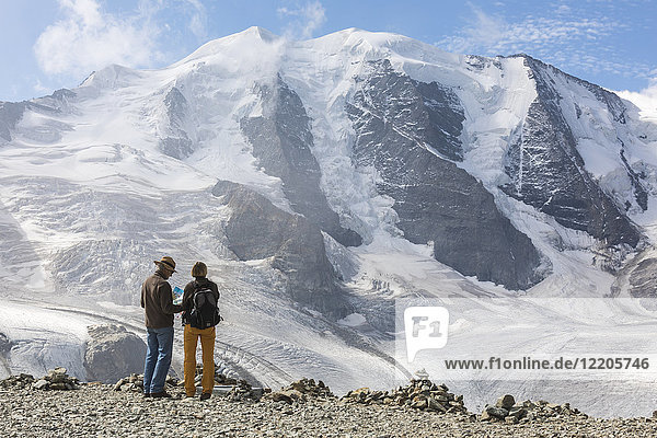 Tourists admire the Diavolezza and Pers glaciers and Piz Palu  St. Moritz  canton of Graubunden  Engadine  Switzerland  Europe