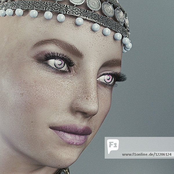 Face of futuristic woman wearing ornate headpiece