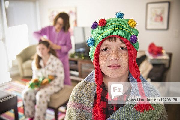Portrait of Caucasian boy wearing Christmas tree stocking-cap