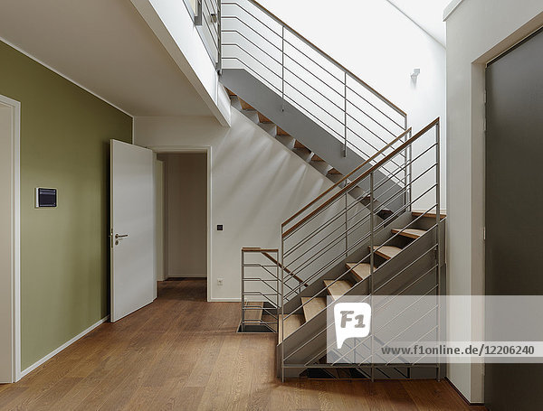 Plank floor and staircase in home
