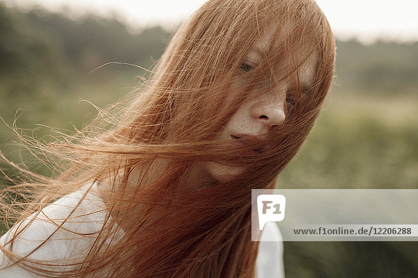Close up of wind blowing hair of Caucasian woman