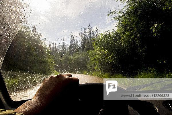 Windshield of car driving in rain