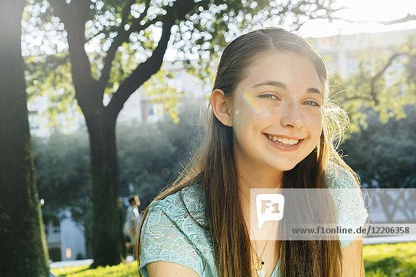 Portrait of smiling Caucasian girl in park