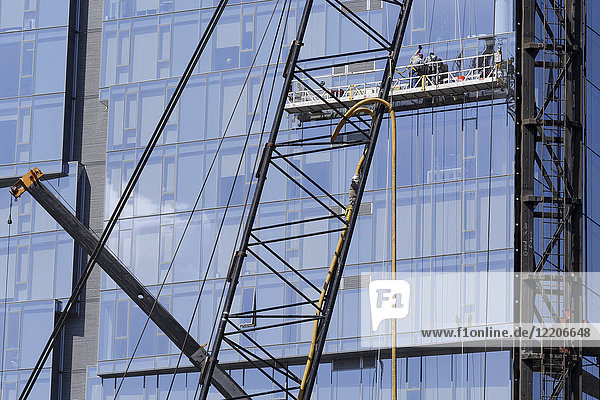 Highrise window washers on scaffolding