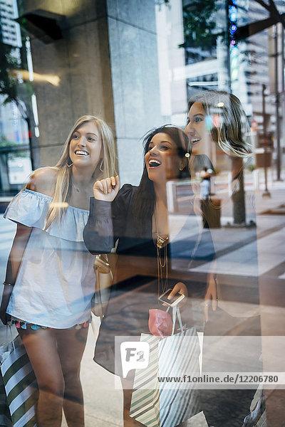 Smiling women window shopping Smiling women window shopping