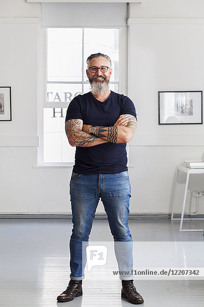 Portrait of smiling muscular Caucasian hipster man