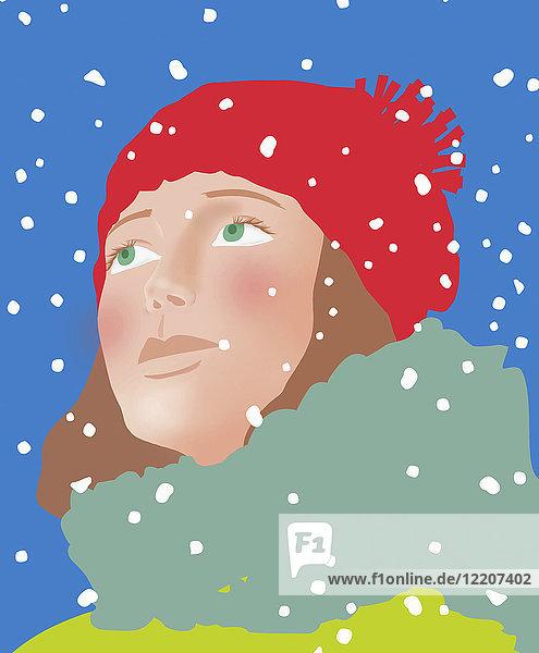 Nahaufnahme des Gesichts einer jungen Frau im Schnee