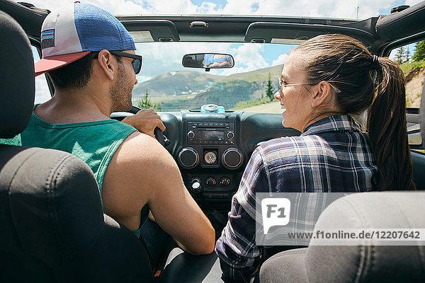 Road trip couple driving on rural road  Breckenridge  Colorado  USA