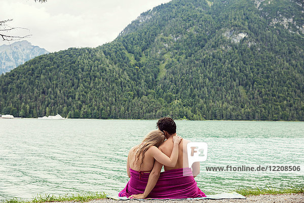 Couple wrapped in towel by Achensee  Innsbruck  Tirol  Austria  Europe