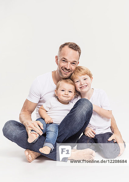 Porträt eines Vaters mit Söhnen