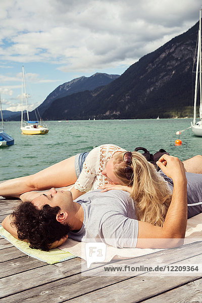 Couple lying together on pier,  Innsbruck,  Tirol,  Austria,  Europe
