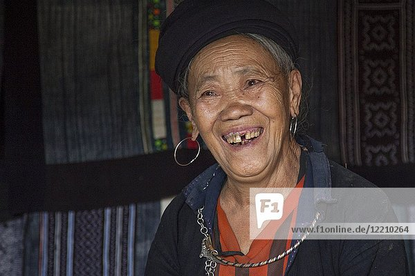Local woman merchant selling textiles in the Cat Cat Village in the valley of Sapa Vietnam.