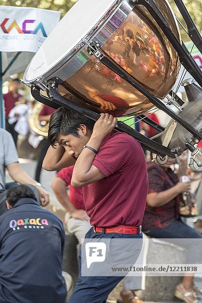Oaxaca,  Oaxaca,  Mexico - A young man carries a drum for a performance during the Día Internacional de la Lengua Materna,  or the International Day of Native Languages. The day is dedicated to the protection of native languages around the world.