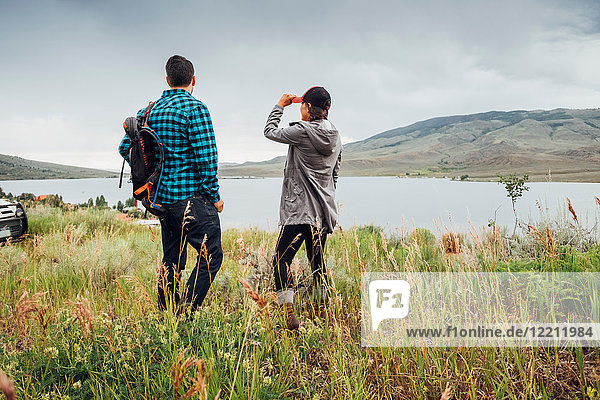 Couple near Dillon Reservoir  looking at view  Silverthorne  Colorado  USA