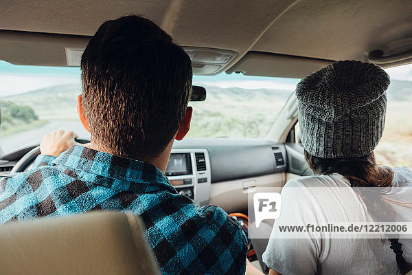 Couple in car  on road trip  rear view  Silverthorne  Colorado  USA