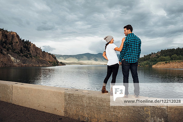 Couple standing on wall beside Dillon Reservoir  Silverthorne  Colorado  USA