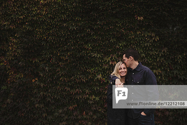 Portrait of mid adult couple  outdoors  hugging