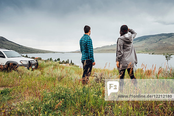 Couple standing beside Dillon Reservoir  looking at view  Silverthorne  Colorado  USA