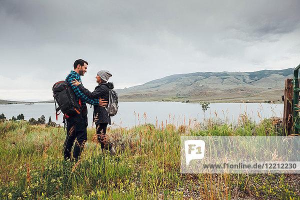 Couple standing beside Dillon Reservoir  face to face  Silverthorne  Colorado  USA