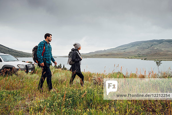 Couple walking beside Dillon Reservoir  Silverthorne  Colorado  USA