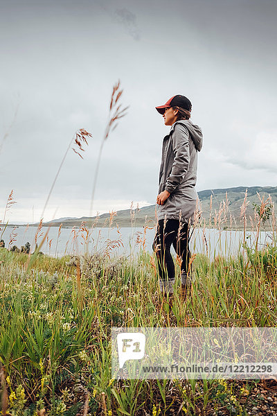 Young woman standing near Dillon Reservoir  looking at view  Silverthorne  Colorado  USA