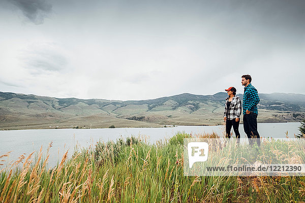 Couple walking near Dillon Reservoir  looking at view  Silverthorne  Colorado  USA