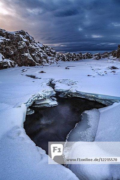 Wintertime by Oxararfoss Waterfall  Thingvellir National Park  Iceland. Unesco World Heritage Site.