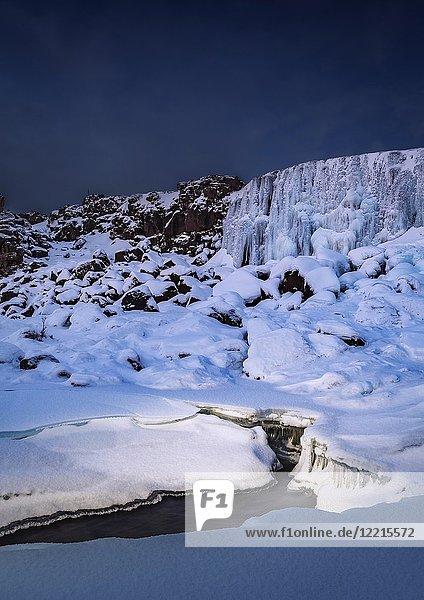 Frozen Oxararfoss Waterfall  Thingvellir National Park  Iceland. Unesco World Heritage Site.