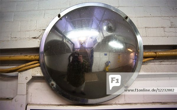 3D Stereo Effect of Photographer's Reflection in Round Metal Security Mirror