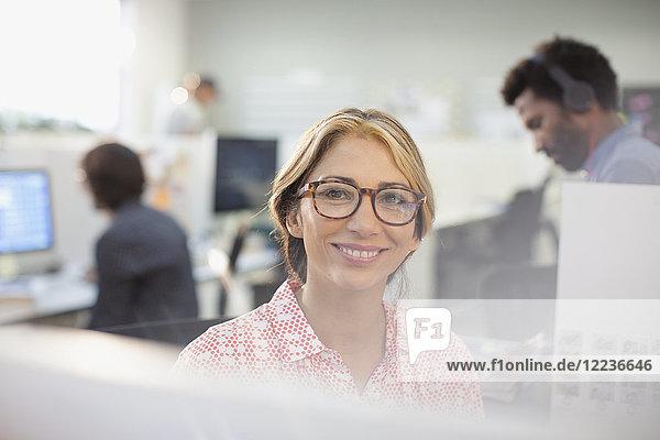 Portrait smiling  confident businesswoman in eyeglasses