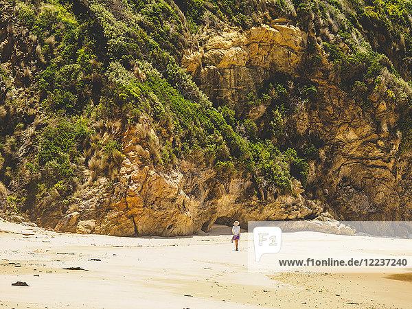 Australia  New South Wales  Bermagui  Woman walking along beach