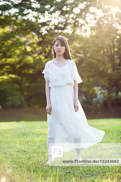 Attractive Japanese woman in a city park
