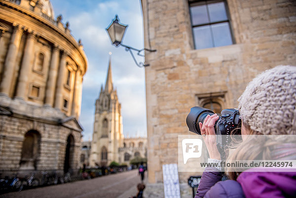 Photographer photographing St. Mary's Church and The Radcliffe Camera in Radcliffe Square  Oxford  Oxfordshire  England  United Kingdom  Europe