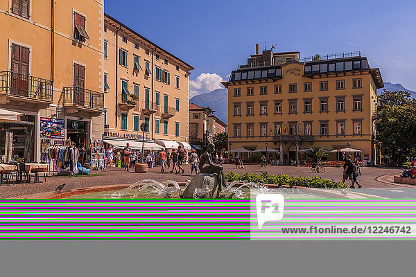 View of fountain and pastel coloured architecture in Piazza Garibaldi  Riva del Garda  Lake Garda  Trentino  Italian Lakes  Italy  Europe