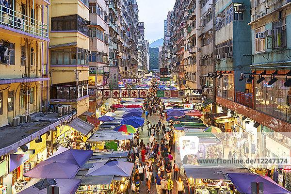 A busy market street in Mong Kok (Mongkok) lit up at dusk  Kowloon  Hong Kong  China  Asia