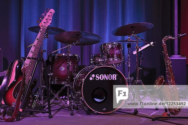 Instruments of a jazz band on stage  big band  electric bass  drums and saxophone