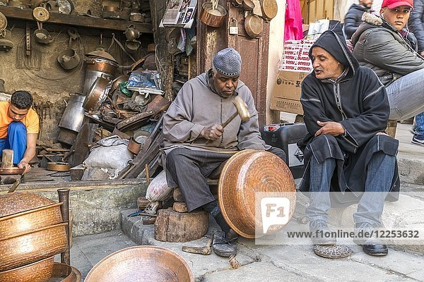 Coppersmiths at work  Place Seffarine  Fez  Morocco  Africa