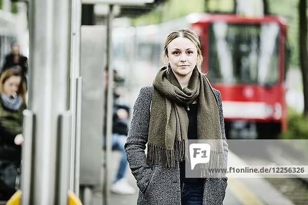 Young woman waiting for the train at a s-Bahn station  Germany  Europe