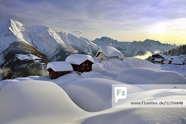 Tief verschneites Bergdorf  Bettmeralp mit Kapelle Maria zum Schnee im Abendlicht  Kanton Wallis  Schweiz  Europa