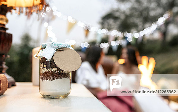 Close-up of wedding gift jar with ingredients to make homemade chocolate cookies